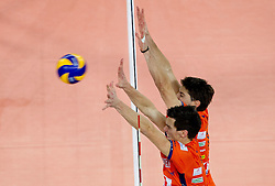 Alen Sket and Matevz Kamnik of ACH during volleyball match between ACH Volley LJUBLJANA and  PGE Skra Belchatow (POL) of 2012 CEV Volleyball Champions League, Men, League Round in Pool F, 4th Leg, on December 20, 2011, in Arena Stozice, Ljubljana, Slovenia. Belchatow defeated ACH 3-0. (Photo By Vid Ponikvar / Sportida.com)