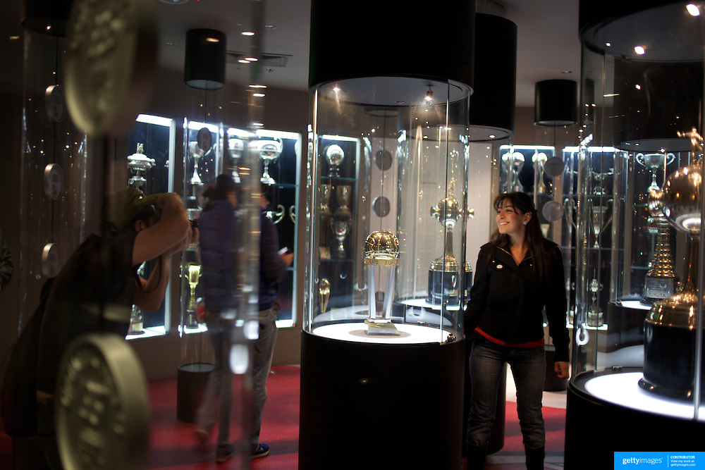 A fan poses for photographs in the trophy room in the museum at River Plates' El Monumental stadium, Buenos Aires, Argentina, 25th June 2010. Photo Tim Clayton...