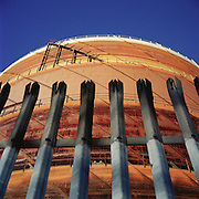 Victorian gasometer behind steel fence. Romford, Essex. 12.2003. UK