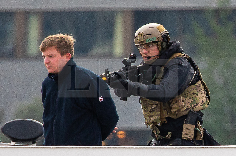 © Licensed to London News Pictures. 24/10/2018. London, UK. Royal Marine Commandos take part in a demonstration on board a City Cruises boat on the River Thames as part of the state visit by Dutch Royals King Willem-Alexander and Queen Maxima. Photo credit : Tom Nicholson/LNP