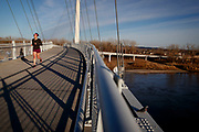 "Ashleigh Buch crosses the Bob Kerrey Pedestrian bridge during a run on Thursday, February 14, 2017 in Omaha. Buch has been an avid runner for years and has completed five marathons. ""Running was always kind of my big, my go to stress reliever and I'd be out on runs kind of just crying just like, 'Why am I like this, why am I like this?' and go to bed praying at night just let me wake up as a woman or as a girl."""