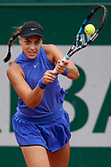 Paris, France - 2017 June 02: Ana Kanjuh from Croatia plays a backhand while her women's double match second round during tennis Grand Slam tournament The French Open 2017 (also called Roland Garros) at Stade Roland Garros on June 02, 2017 in Paris, France.<br /> <br /> Mandatory credit:<br /> Photo by © Adam Nurkiewicz<br /> <br /> Adam Nurkiewicz declares that he has no rights to the image of people at the photographs of his authorship.<br /> <br /> Picture also available in RAW (NEF) or TIFF format on special request.<br /> <br /> Any editorial, commercial or promotional use requires written permission from the author of image.