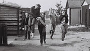 Teenagers running, Greenford, London, UK, 1980s.