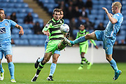 Forest Green Rovers Christian Doidge(9) and Coventry City's Jack Grimmer(2) go for the ball during the EFL Sky Bet League 2 match between Coventry City and Forest Green Rovers at the Ricoh Arena, Coventry, England on 17 October 2017. Photo by Shane Healey.