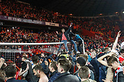 Charlton Athletic football fans, football supporters, pitch invasion, after the EFL Sky Bet League 1 second leg Play-Off match between Charlton Athletic and Doncaster Rovers at The Valley, London, England on 17 May 2019.