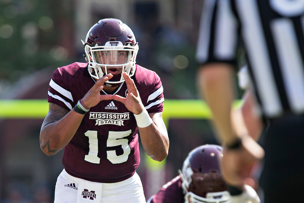 STARKVILLE, MS - SEPTEMBER 19:  Dak Prescott #15 of the Mississippi State Bulldogs calls signals at the line of scrimmage during a game against the Northwestern State Demons at Davis Wade Stadium on September 19, 2015 in Starkville, Mississippi.  The Bulldogs defeated the Demons 62-13.  (Photo by Wesley Hitt/Getty Images) *** Local Caption *** Dak Prescott