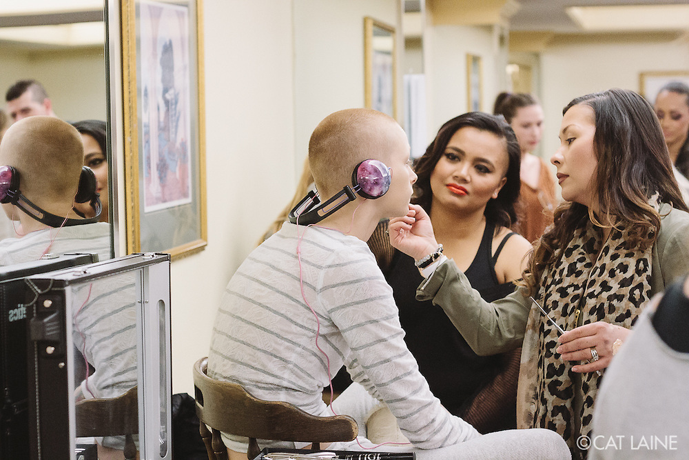 PROVIDENCE, RI - FEB 13: Nicole Le Duc Dawson does Amy-Beth's makeup as another makeup artist observes backstage prior to the Stetkewicz show as part of StyleWeek NorthEast on February 13, 2015 in Providence, Rhode Island. (Photo by Cat Laine)
