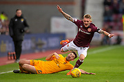 Shaun Byrne (#6) of Livingston FC fouls Callumn Morrison (#38) of Heart of Midlothian during the 4th round of the William Hill Scottish Cup match between Heart of Midlothian and Livingston at Tynecastle Stadium, Edinburgh, Scotland on 20 January 2019.