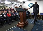 President Barack Obama leave the podium after delivering his final press conference for the year at the White House.