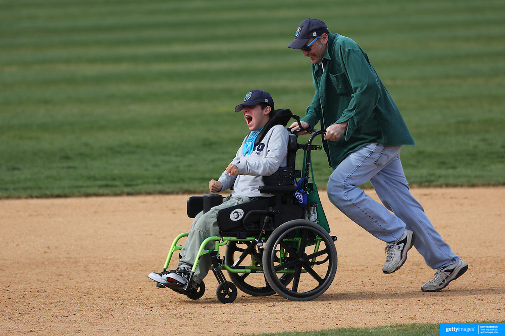 Running the bases at the end of the game after the Bridgeport Bluefish V York Revolution, Atlantic League, Minor League ballgame at Harbor Yard Ballpark, Bridgeport, Connecticut, USA. Photo Tim Clayton