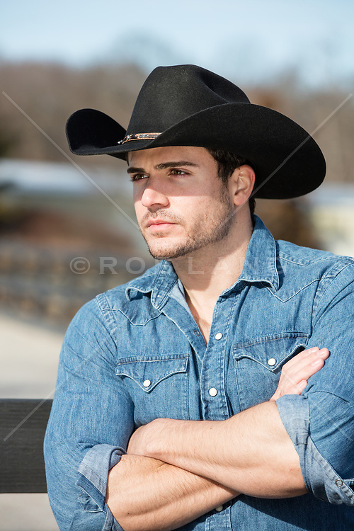 hot cowboy with his arms crossed