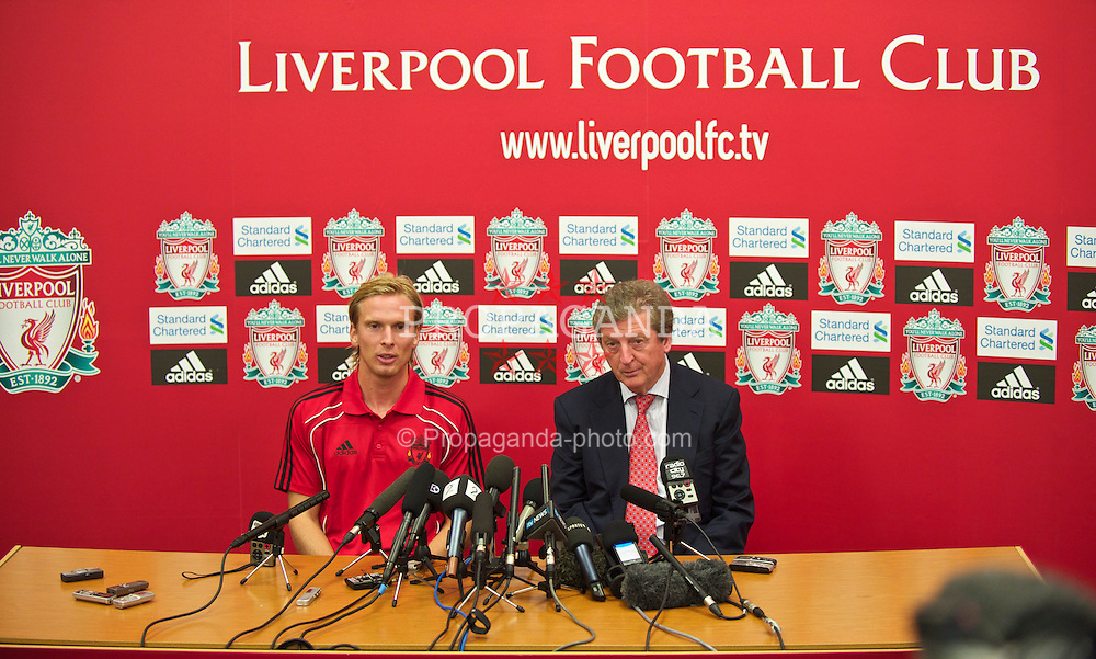 LIVERPOOL, ENGLAND - Friday, August 13, 2010: Liverpool's new signing Christian Poulsen with manager Roy Hodgson at a press conference at the club's Melwood Training Ground. The 30-year-old Danish international midfielder Poulsen joins the Reds from Italian side Juventus on a three-year deal. (Pic by: David Rawcliffe/Propaganda)