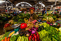 Woman selling produce in the market, Shangri La, Yunnan Province, China.