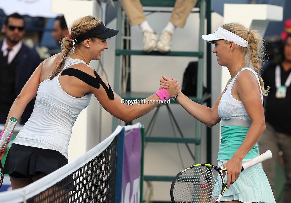 18.02.2014. Dubai, UAE. Dubai Tennis Championships 2014,WTA Tennis International Series Sabine Lisicki (GER) shakes hands with Caroline Wozniacki (DEN)