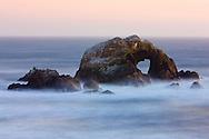 Surf breaking over Seal Rock at sunset - San Francisco, California