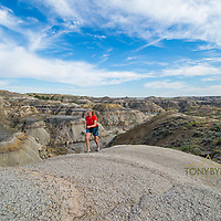painted hills and badlands near for peck lake woman hiking on ridge