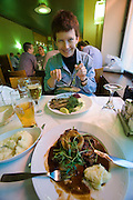 Sea Horse restaurant. Nicole Schmidt eating delicious baltic herrings.