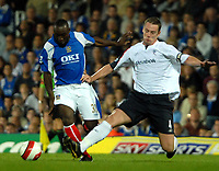 Photo: Ed Godden.<br /> Portsmouth v Bolton Wanderers. The Barclays Premiership. 25/09/2006. Portsmouth's Lomana Lua Lua (L) is challenged by Kevin Nolan.