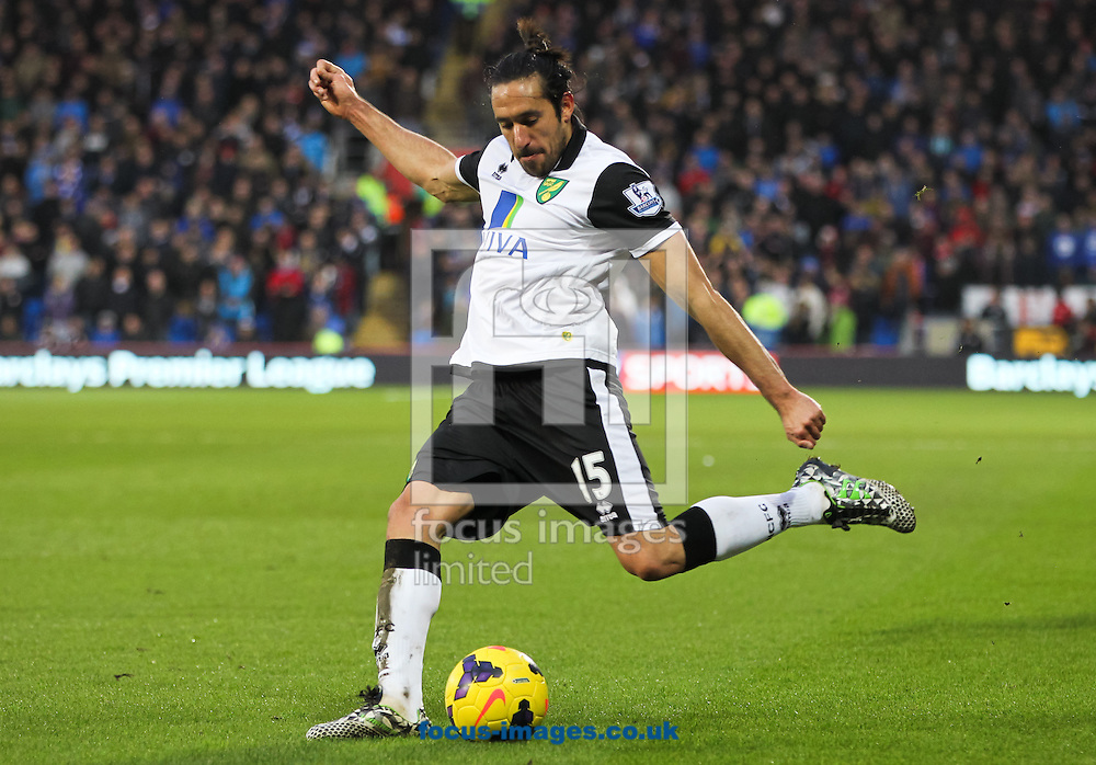 Picture by Tom Smith/Focus Images Ltd 07545141164<br /> 01/02/2014<br /> Jon&aacute;s Guti&eacute;rrez of Norwich City crosses the ball during the Barclays Premier League match at the Cardiff City Stadium, Cardiff.