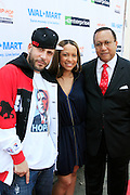 "DJ Drama, Valiesha Butterfield and Dr. Benjamin Chavis Muhummad at the Hip-Hop Summit's ""Get Your Money Right"" Financial Empowerment International Tour draws hip-hop stars and financial experts to teach young people about financial literacy held at The Johnson C. Smith University's Brayboy Gymnasium on April 26, 2008..For the past three years, hip-hop stars have come out around the country to give back to their communities. Sharing personal stories about the mistakes they've made with their own finances along the way, and emphasizing the difference between the bling fantasy of videos and the realities of life, has helped young people learn the importance of financial responsibility while they're still young. With the recent housing market crash in the United States affecting the economy, jobs, student loans and consumer confidence, young people are eager to receive sound financial advice on how to best manage their money and navigate through this volatile economic environment.."
