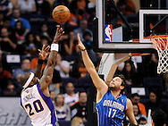 Dec. 09, 2012; Phoenix, AZ, USA; Phoenix Suns center Jermaine O'Neal (20) puts up a shot during the game against the Orlando Magic forward Josh McRoberts (17) in the first half at US Airways Center. The Magic defeated the Suns 98-90. Mandatory Credit: Jennifer Stewart-USA TODAY Sports