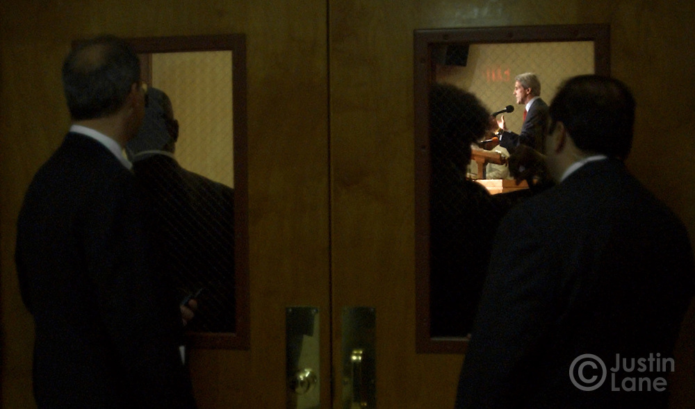 United States Senator and Democratic Candidate for President John Kerry, seen through window, speaks during mass at Mt. Olivet Baptist Church in Columbus, OH on Sunday, 17 October 2004. In the foreground are two Secret Service agents...EPA/JUSTIN LANE