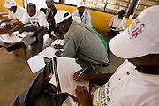 Vaccination teams compile the results of the day's vaccination after a second day of work during a national polio immunization exercise in Tamale, Ghana on Friday March 27, 2009.