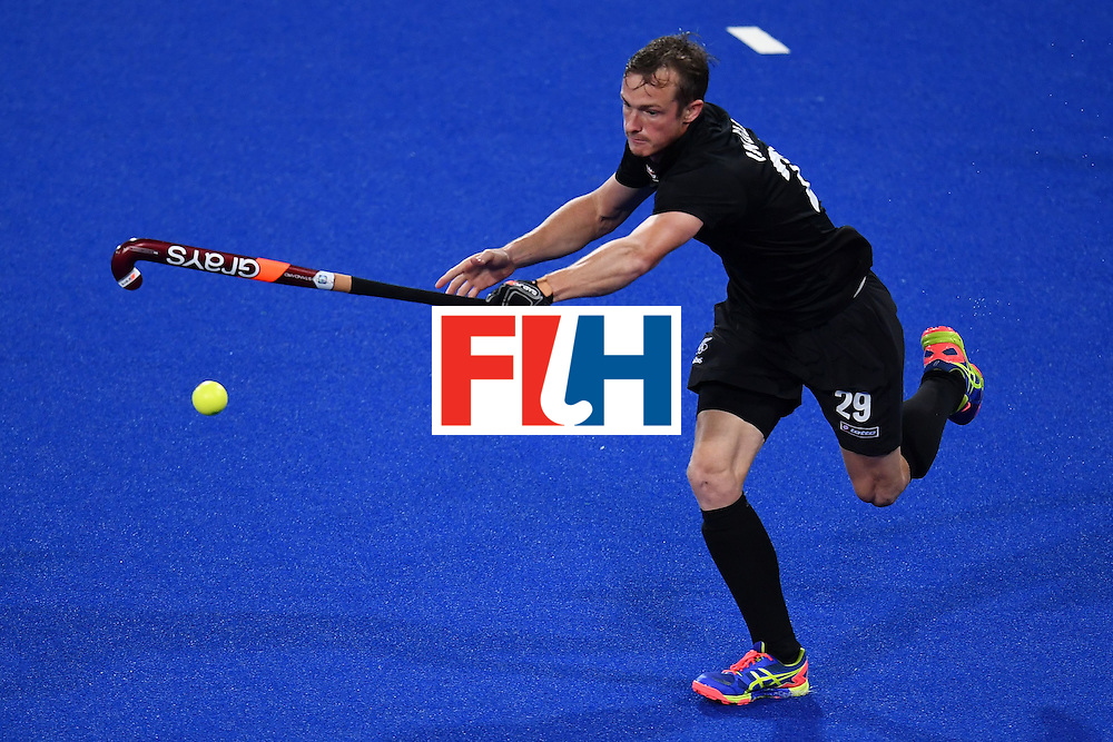 New Zealand's Hugo Inglis plays the ball during the mens's field hockey Belgium vs New Zealand match of the Rio 2016 Olympics Games at the Olympic Hockey Centre in Rio de Janeiro on August, 12 2016. / AFP / MANAN VATSYAYANA        (Photo credit should read MANAN VATSYAYANA/AFP/Getty Images)
