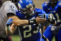 Coeur d'Alene High running back Zach Keiser pushes through a tackle for more yardage during the second half.