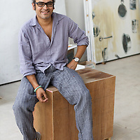 "Subodh Gupta, contemporary artist with works-in-progress in his recently completed studio in Gurgaon, a satellite town of Delhi...Gupta's most celebrated sculptures are constructed from common domestic items including the steel pots and pans that are a feature every Indian home. Of the kitchen-ware that forms the basis of his work, Gupta says,..""The poor, the middle class and the rich use it at home. In this country, how many people have the utensils but they starve because there is no food?""..Gupta was brought up, one of six children, to a railway-worker father in a north Indian village. ..Gupta's work fetches such huge sums of money. Two versions of his Mind Shut Down, modeled on the human skull and constructed entirely of steel kitchen utensils recently sold for EUR1 million each...Photo: Tom Pietrasik.Gurgaon, Haryana. India. .June 26th 2009"