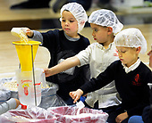 St. Pius Students Package Meals for Needy