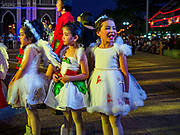 "23 DECEMBER 2018 - CHANTABURI, THAILAND: Performers wait to go on stage during the pageant at the Cathedral of the Immaculate Conception's Christmas Fair in Chantaburi. Cathedral of the Immaculate Conception is holding its annual Christmas festival, this year called ""Sweet Christmas @ Chantaburi 2018"". The Cathedral is the largest Catholic church in Thailand and was founded more than 300 years ago by Vietnamese Catholics who settled in Thailand, then Siam.  PHOTO BY JACK KURTZ"