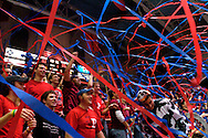In old Ivy League tradition, Penn fans throw red and blue streamers onto the court after the Quakers score their first point.  The banned practice was brought back, Saturday January 28, 2006 as the University of Pennsylvania took on local rival Saint Joseph's at The Palestra in Philadelphia.  John Pavoncello photo