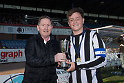 John Burke of Dundee Supporters' Association presents the Urquhart Trophy to Baldragon captain Kyler Van Tooom after Baldragon had beaten St. Johns 2-0 in the final -  Baldragon v St.John's in the U14 Urquhart Trophy Final (sponsored by DSA) at Dens Park, Dundee<br /> <br /> <br />  - &copy; David Young - www.davidyoungphoto.co.uk - email: davidyoungphoto@gmail.com