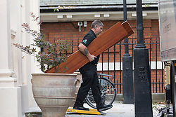 © Licensed to London News Pictures. 30/07/2018. London, UK.  Removal men taking items into a van outside the Foreign Secretary's official residence at Carlton Gardens in central London where the former Foreign Secretary, Boris Johnson is moving out following his resignation.  Photo credit: Vickie Flores/LNP