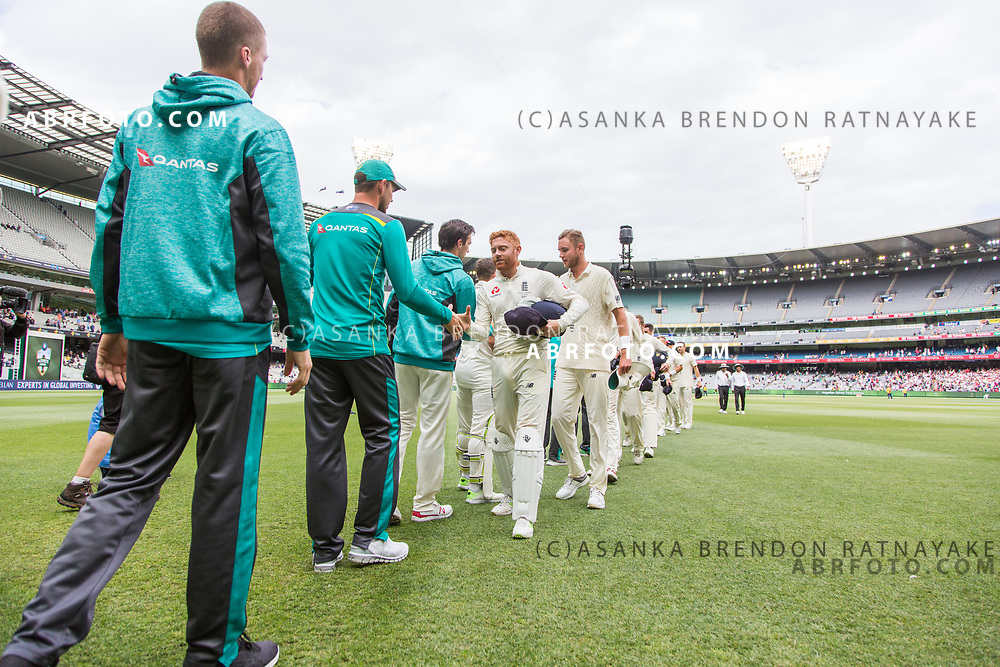 Jonny Bairstow shakes hands with Australian players during day 5 of the 2017 boxing day test.