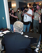 3/12/07 Omaha NE Nebraska Senator Chuck Hagel is surrounded by media as he gives a radio interview after he announced he is waiting to decide about running for President at the University of Nebraska  at Omaha. (photo by Chris Machian/Prairie Pixel Group)