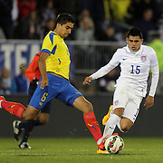 Joe Corona Crespin, (right), USA, challenges Christian Noboa, Ecuador, during the USA Vs Ecuador International match at Rentschler Field, Hartford, Connecticut. USA. 10th October 2014. Photo Tim Clayton