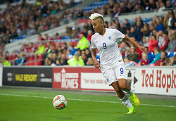 CARDIFF, WALES - Tuesday, August 21, 2014: England's Lianne Sanderson in action against Wales during the FIFA Women's World Cup Canada 2015 Qualifying Group 6 match at the Cardiff City Stadium. (Pic by Ian Cook/Propaganda)