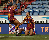 Jordan Turner (L) celebrates with try scorer Darnell McIntosh (R) of Huddersfield Giants and \wak of Wakefield Trinity during the Betfred Super League match at the John Smiths Stadium, Huddersfield<br /> Picture by Richard Land/Focus Images Ltd +44 7713 507003<br /> 27/07/2018