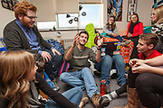 Freshmen gather and chat in a dorm room at Escalante Hall.