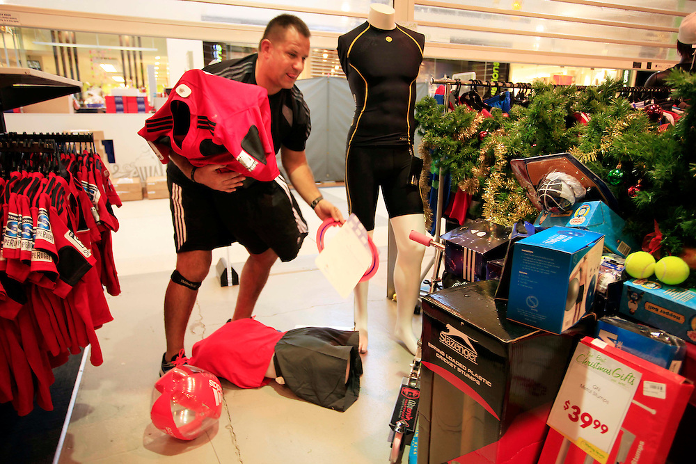 Simon Kneebone, owner Stirling Sports Northlands cleaning up following a swarm of earthquakes, Christchurch, Saturday, December 24, 2011.  Credit:SNPA / Pam Johnson