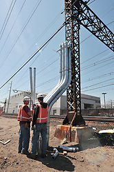 Engineers discussing conduit installation at Catenary. Construction Progress Photography of the Railroad Station at Fairfield Metro Center - Site visit 10 of once per month Chronological Documentation.