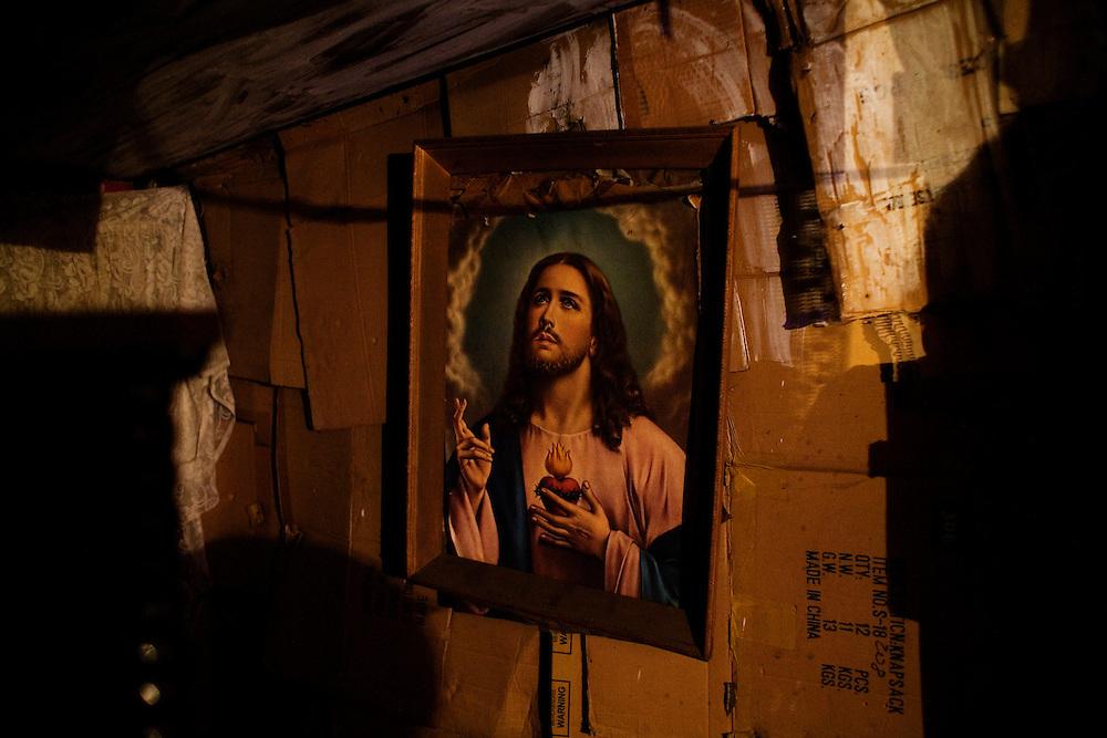 A portrait of Jesus hangs in a home in the Stara Gazela settlement of Belgrade. August 2009.