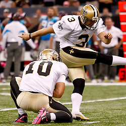 October 3, 2010; New Orleans, LA, USA; New Orleans Saints place kicker John Carney (3) kicks a field goal against the Carolina Panthers during a game at the Louisiana Superdome. The Saints defeated the Panthers 16-14. Mandatory Credit: Derick E. Hingle