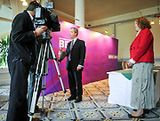 © Licensed to London News Pictures. 24/03/2015. Folkstone, UK. HARRIET YEO watches NIGEL FARAGE give a television interview. Harriet Yeo has been named as Ukip's new Folkestone and Hythe general election candidate following the expulsion of Janice Atkinson over allegations of an inflated expenses claim.. Photo credit : Stephen Simpson/LNP