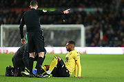 Millwall defender Mahlon Romeo (12) receives treatment during the EFL Sky Bet Championship match between Derby County and Millwall at the Pride Park, Derby, England on 14 December 2019.