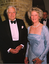 REAR-ADM.SIR NIGEL & LADY CECIL, at a fashion show in London on 12th May 1998.MHL 10