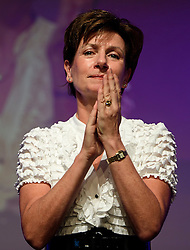 ©  London News Pictures. 17/09/2016. Bournemouth, UK. Party leader DIANE JAMES joins UKIP supporters as they hold a minutes applause in the memory of UKIP campaigners who have died, at Day 2 of the 2016 UKIP Autumn Conference, held at the Bournemouth International Centre in Bournemouth, Dorset. On Friday, the party elected Diane James as their new leader, following Nigel Farage resignation after the UK voted to leave the EU in a referendum..  Photo credit: Ben Cawthra/LNP