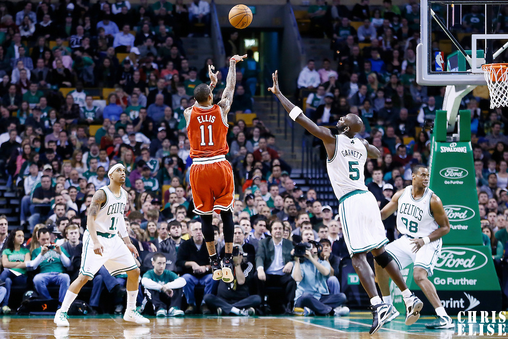 21 December 2012: Milwaukee Bucks point guard Monta Ellis (11) takes a jumpshot over Boston Celtics power forward Kevin Garnett (5) during the Milwaukee Bucks 99-94 overtime victory over the Boston Celtics at the TD Garden, Boston, Massachusetts, USA.